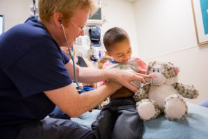 Dr. Paul Walsh treats a child in the dedicated Pediatric Emergency Department at Sutter Medical Center, Sacramento.