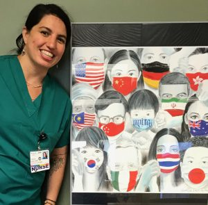 Female nurse poses in front of painting