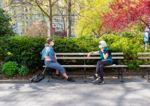 Women social distancing and wearing face mask in New York City.
