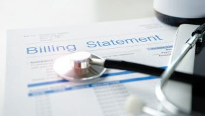 A hospital billing statement with a stethoscope