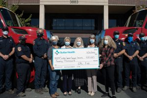 CalFire and Sutter Support Services pose together with $20,000 check