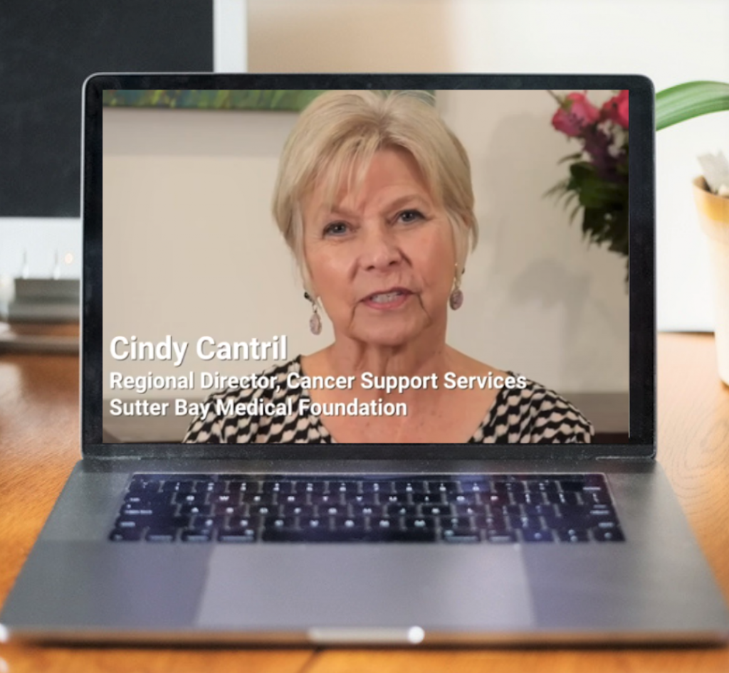 Cindi Cantril, regional director, appears on a laptop screen