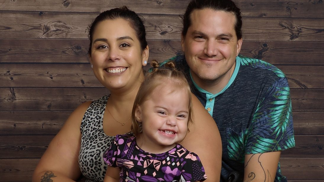 Mother in wheelchair with daughter and husband