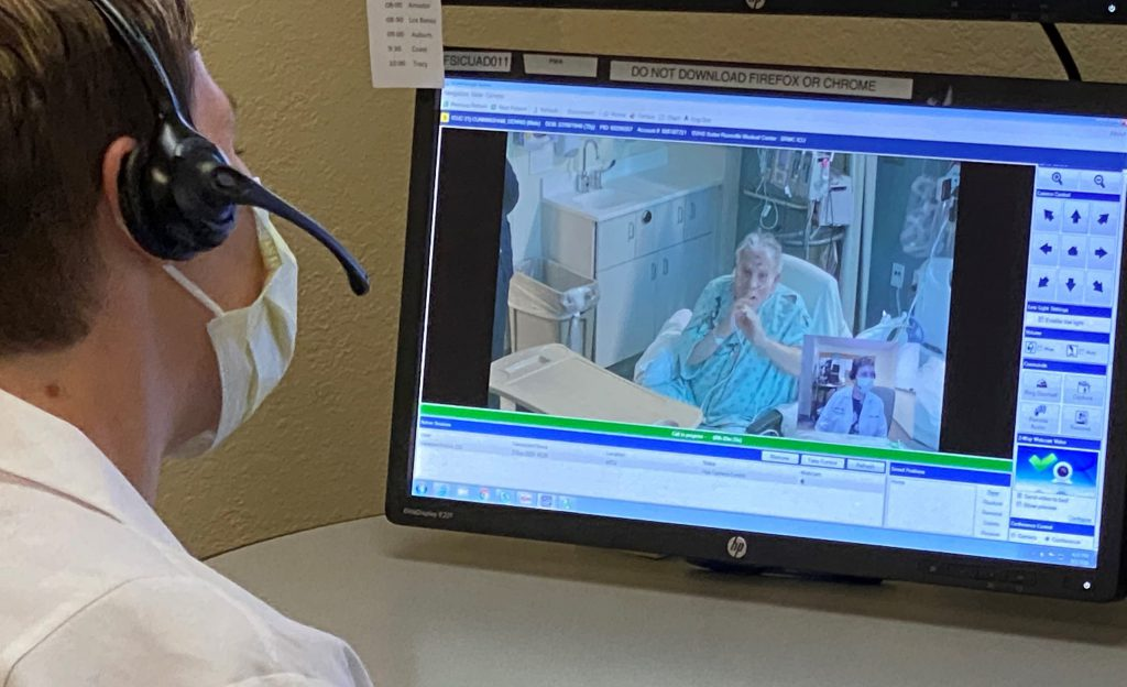 Doctor checking patient on screen