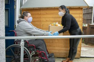 Delivering Food to the Disabled in Quarantine During Covid-19 Coronavirus Pandemic