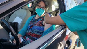 Woman gets vaccine shot in car
