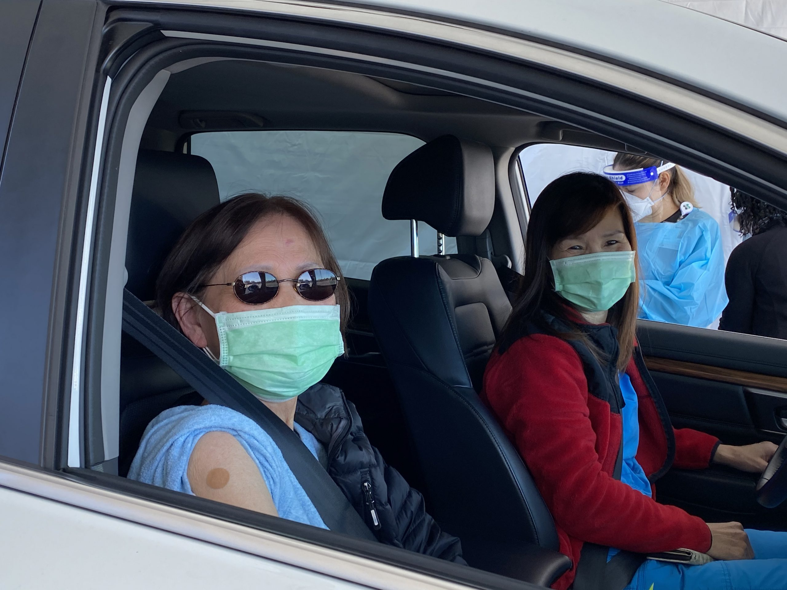 Elderly Asian woman with Adult Daughter in Car
