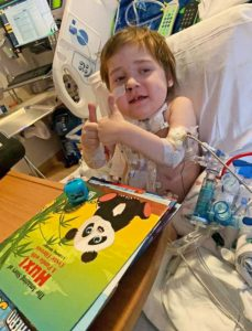 Hospitalized boy with books