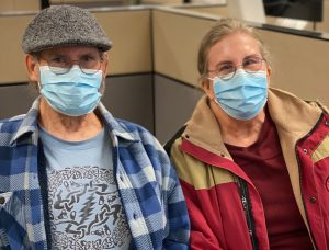 Elderly couple with surgical masks