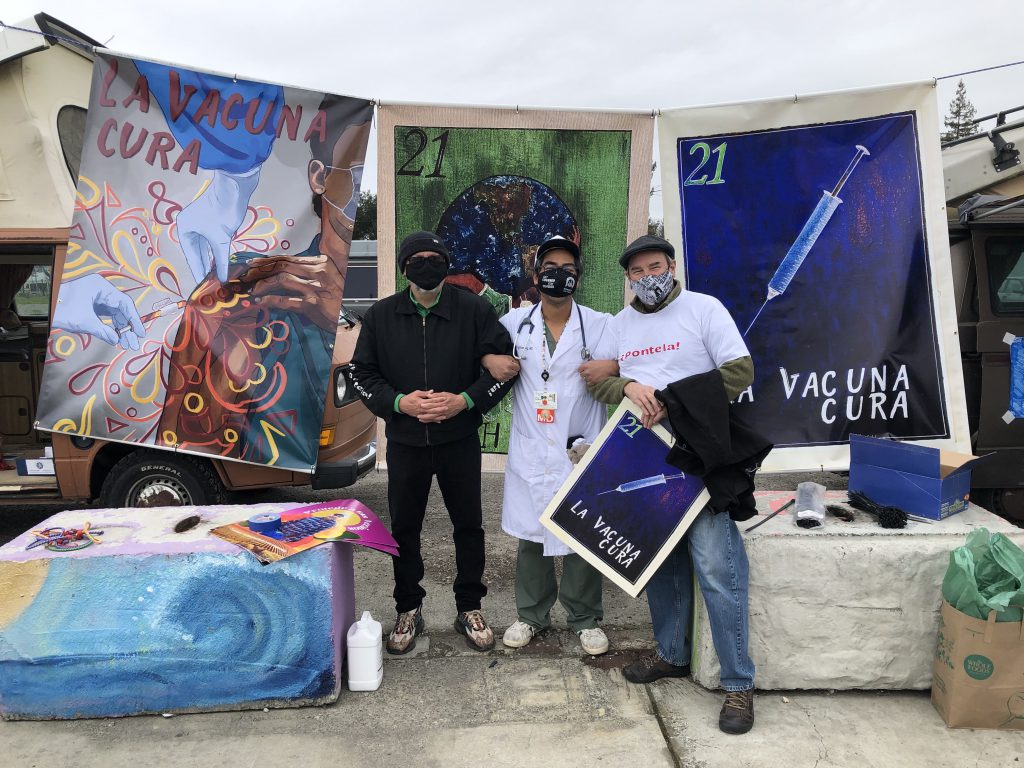 Dr. Brian Prystowsky stands with other members helping to educate Sonoma County's Latinx population through artwork that addresses COVID-19 vaccine hesitancy.