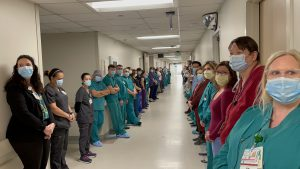 Medical staff line the halls at the hospital