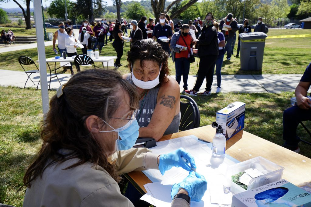 Woman receives her second dose of the COVID-19 vaccine at a pop-up clinic in Santa Rosa