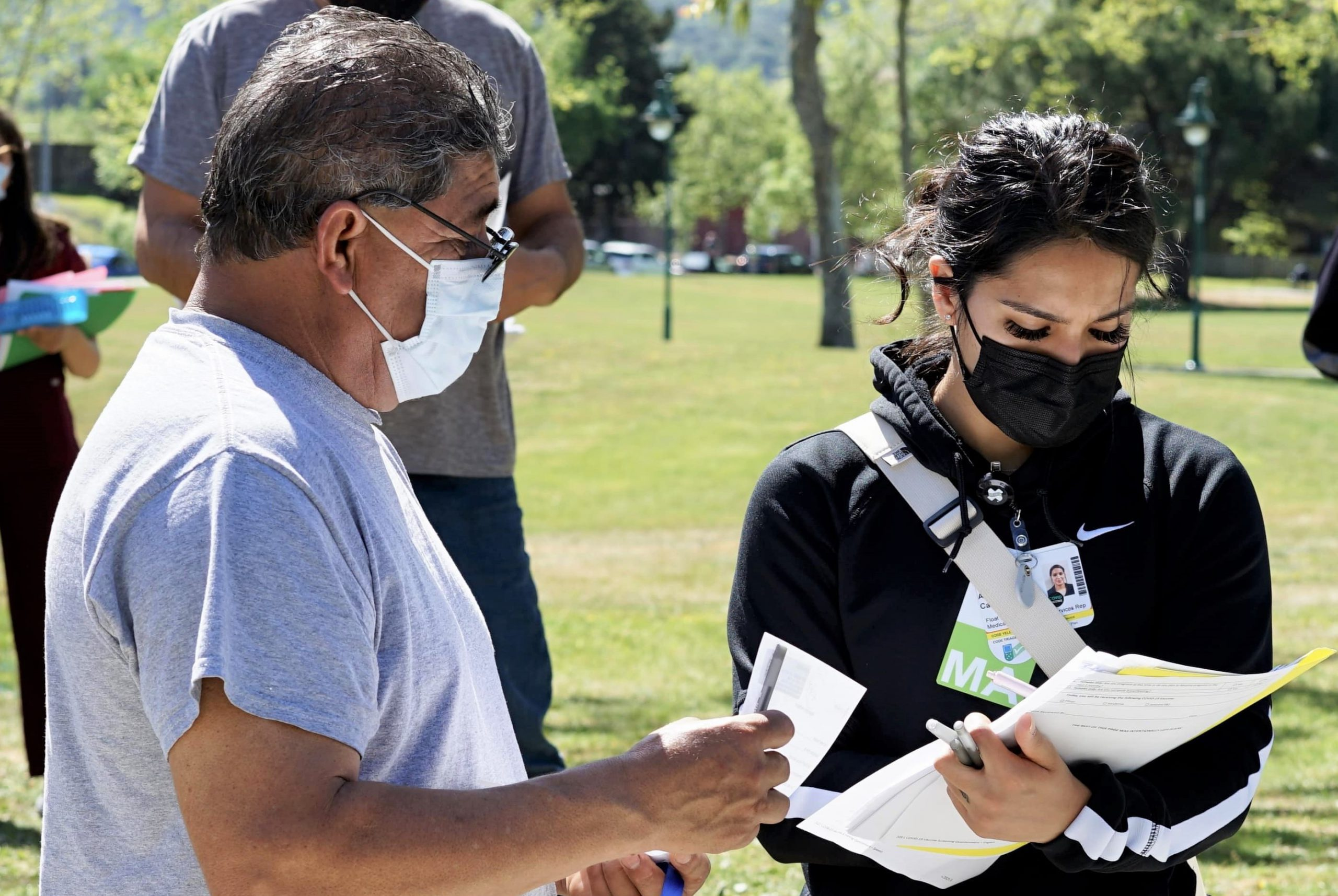 A doctor and Latino community member discuss vaccination