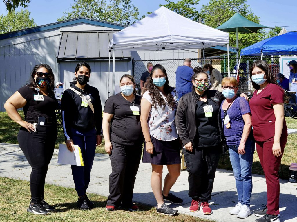 A handful of Sutter Health medical volunteers pose for a photo at a recent vaccine pop up clinic in Santa Rosa, California