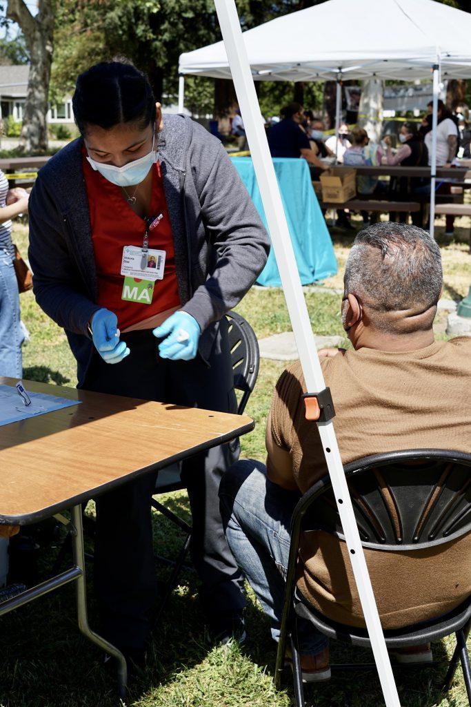 A Latino man gets vaccinated at a pop up clinic in Santa Rosa, California