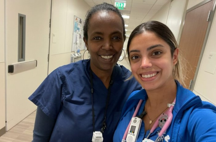 Yodit Mender, CNA, and Kayla Elias, RN, stand side by side at CPMC Van Ness Campus hospital where they now work together