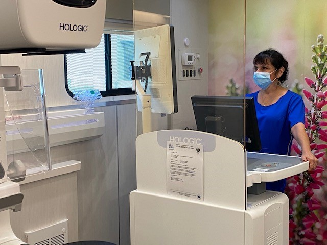 Mammography tech with 3D mammography machine
