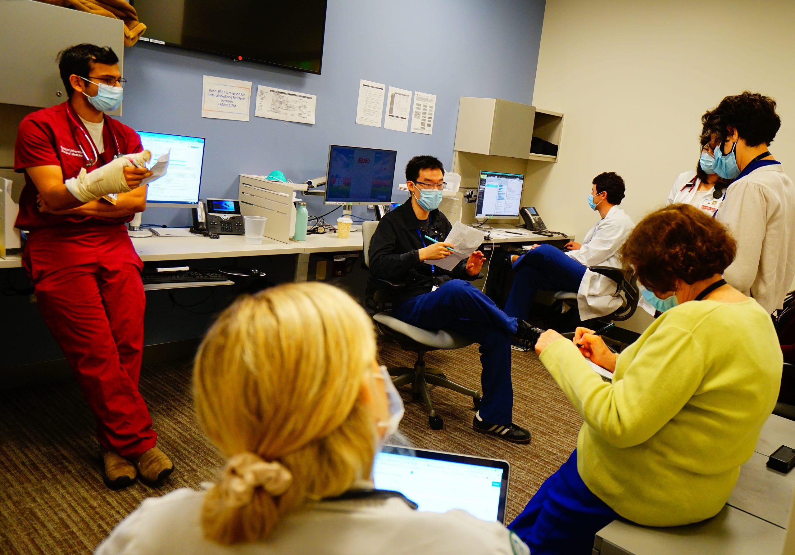Residents discuss patient cases